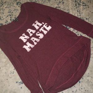 Maroon sweater.